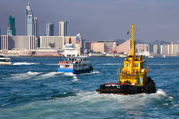Tugboat and ferry in Hong Kong harbour