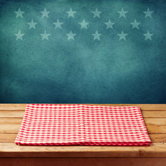 Empty wooden deck table with tablecloth for USA holidays