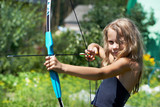 Girl shoots a bow