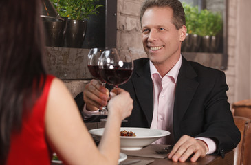 Spending their time together at the restaurant. Mature couple dr