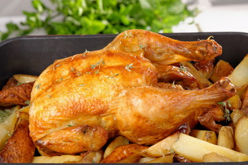 Roasted chicken and potato on white background