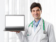 doctor holding a laptop with blank screen