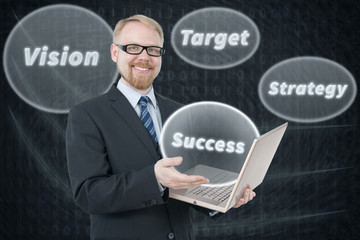 Businessman Holding Laptop with Keywords to Success Around