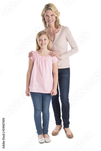 Mother And Daughter Smiling Together Over White Background