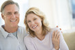 Loving Mature Couple Smiling At Home
