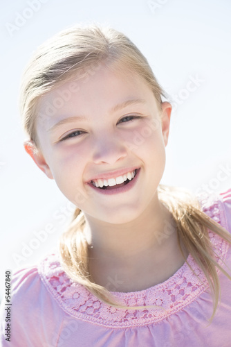 Cute Girl Smiling Against Clear Sky