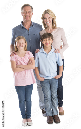 Happy Family Of Four Smiling Against White Background