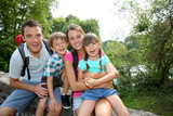 Happy family relaxing on a bridge