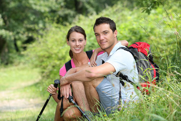 Couple on a trekking day in forest