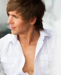 Handsome young man in white shirt