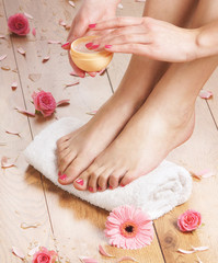 Close-up image of sexy female feet with cream added