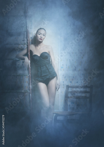 Fashion shoot of a young woman posing in erotic lingerie