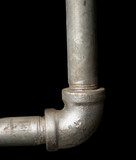 90 elbow galvanized steel pipe on black background poster