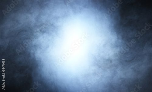 A beautiful blue smoke background with light in the center