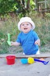 happy baby plays with sand