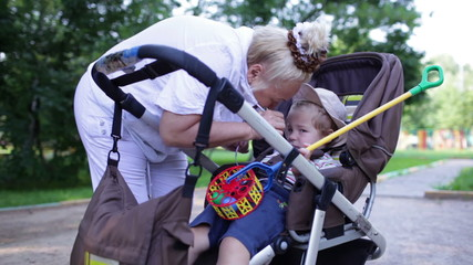 Naughty boy in the buggy with granny.