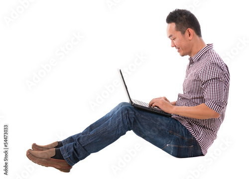 Asian man using laptop