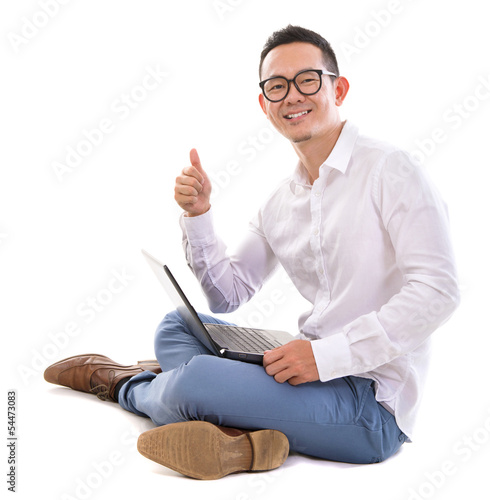 Thumb up Asian man using laptop