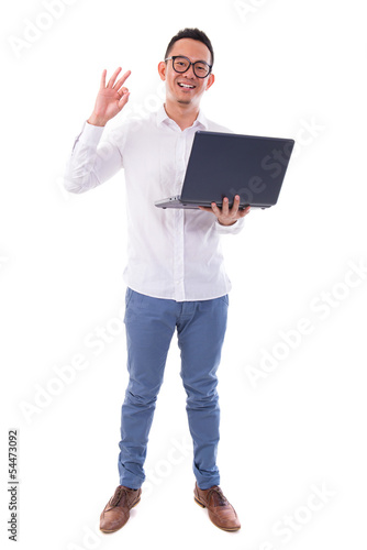 Asian man using laptop showing ok sign
