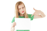 Pretty young girl showing empty blank paper sign for text.