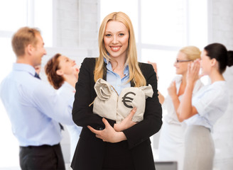 businesswoman holding money bags with euro