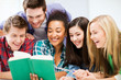 students reading book at school