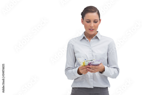 Businesswoman counting euro notes