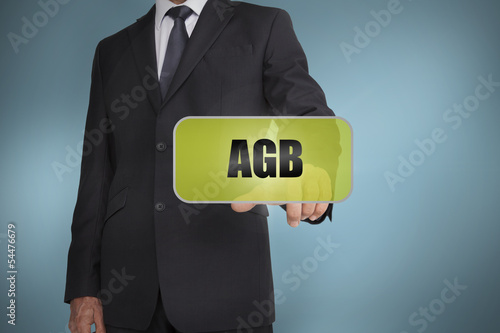 Businessman selecting green label with agb written on it