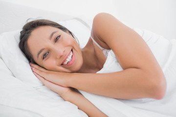 Pretty woman resting in bed