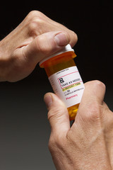 Opening prescription bottle, vertical