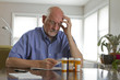 Older man with prescription medications, horizontal