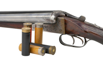 two trigger old shotgun isolated with cartridges