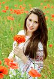 brunette girl in poppes field