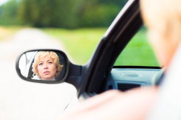 Lady driving a car.