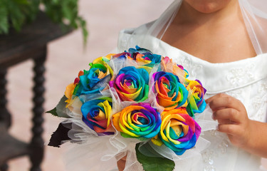 Young girl with colorful bouquet