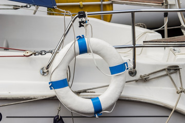 white lifebuoy with rope