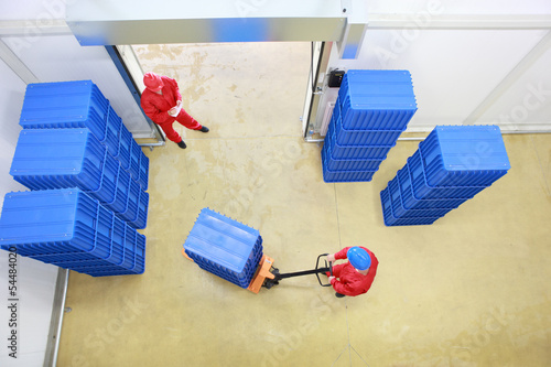 workers preparing goods delivery in a small company warehouse