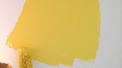 Painting wall in yellow color