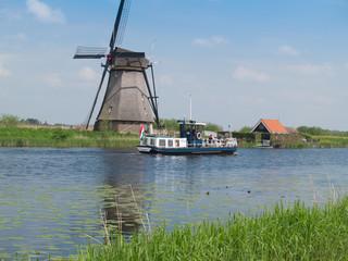 holland rural windmill in Kinderdijk over water