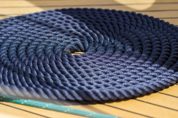 Thick rope wrapped in a spiral on the ship's deck