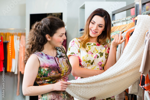 Young women shopping fashion in department store