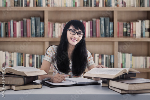 Beautiful female student study at library