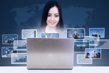 Businesswoman search online report using laptop