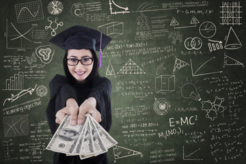 Asian female graduate giving money in class
