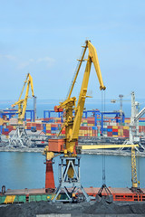 Cargo crane, freight traine and coal in port