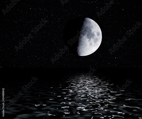Half moon with stars reflected in water surface.