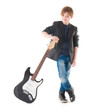 Handsome boy with electric guitar posing