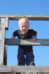 Baby on Wooden Bridge