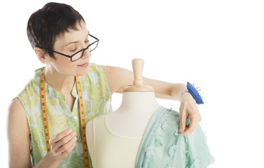 Fashion Designer Pinning Clothes To Mannequin