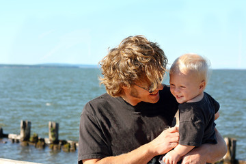 Father and Baby Laughing at the Lake